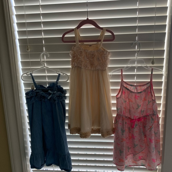 A bundle of 3 5T dresses